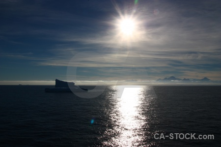 Cloud antarctica cruise mountain iceberg sun.