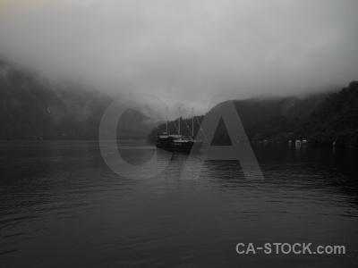 Cloud fiord vehicle boat fiordland.