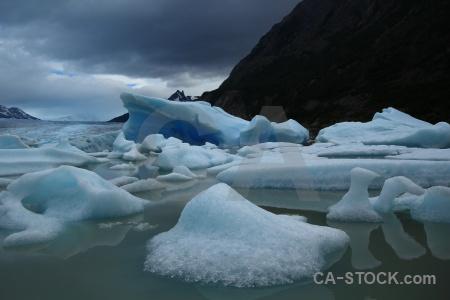 Cloud glacier iceberg lake grey mountain.