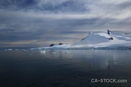 Cloud marguerite bay antarctic peninsula landscape snowcap.