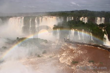 Cloud rainbow iguazu falls south america river.