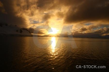Cloud sun paradise harbour antarctica cruise antarctic peninsula.