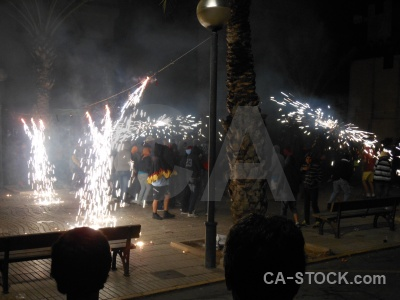 Correfocs person firework javea building.
