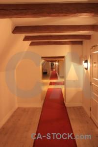 Corridor building orange red interior.