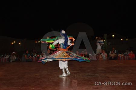 Costume dancing arabic spin person.