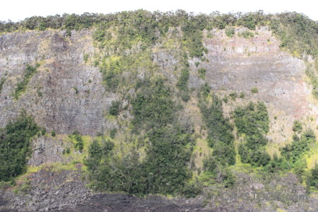 Crater green volcanic cliff.