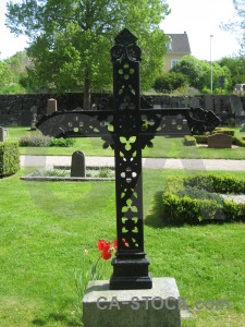 Cross statue grave green cemetery.