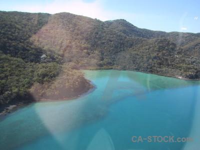 Cyan water island sea aerial.