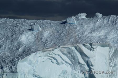 Day 5 iceberg cloud sky antarctica.
