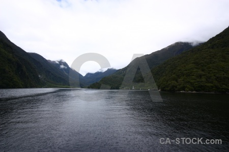 Doubtful sound mountain cloud fiord south island.