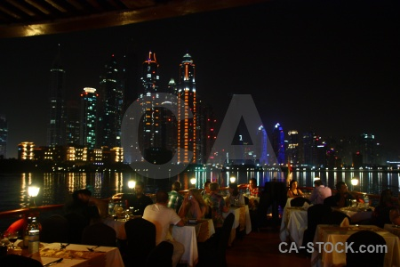 Dubai person night cityscape table.