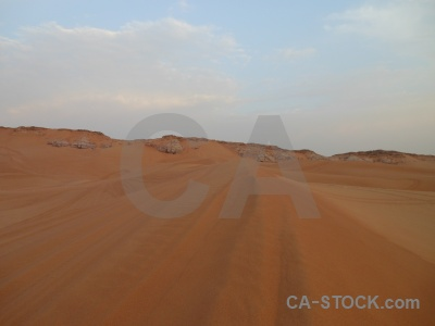 Dubai sand cloud middle east desert.