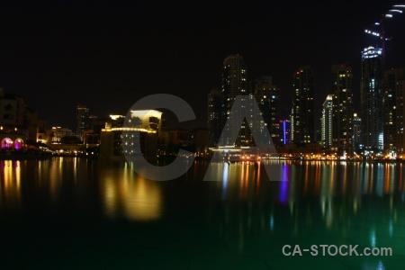 Dubai skyscraper reflection water building.