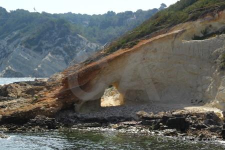Europe javea cliff rock tunnel.