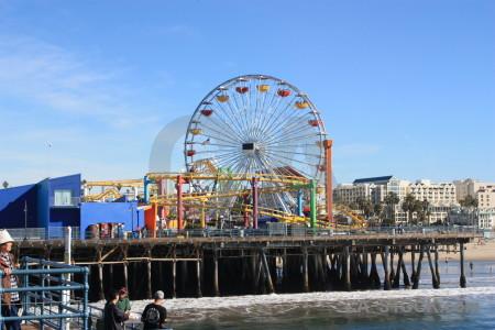 Fairground person ferris wheel blue.