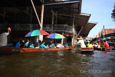 Floating canal person damnoen saduak southeast asia.