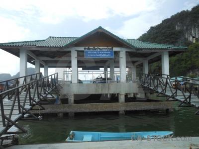Floating island stilts water building.