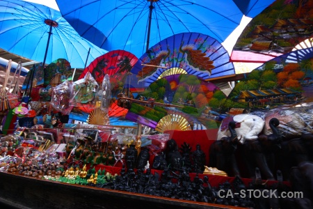Floating market asia damnoen saduak umbrella.