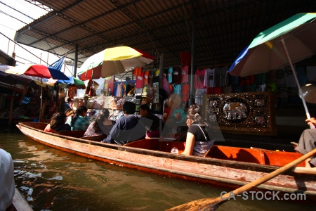 Floating water umbrella boat damnoen saduak.