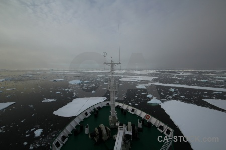 Fog antarctica sea ice water boat.