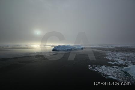 Fog snow antarctica sun adelaide island.