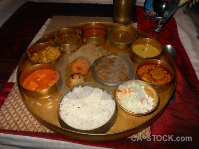 Food inside bati india curry.