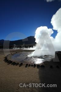 Geyser water pool sun atacama desert.
