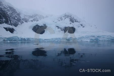 Glacier reflection mountain cloud antarctica cruise.