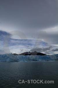 Glacier terminus water lake argentino sky.
