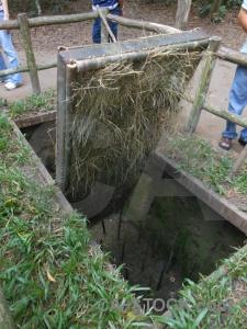 Grass cu chi tunnels trap door vietnam viet cong.