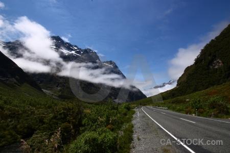 Grass road sky landscape mountain.