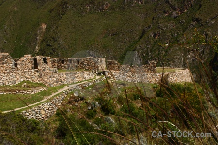 Grass stone south america inca ruin.