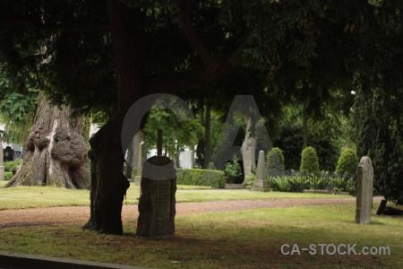 Grave green cemetery statue black.
