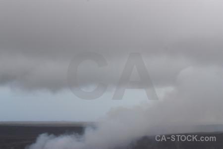 Gray crater volcanic smoke.
