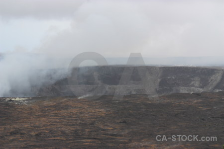 Gray landscape volcanic smoke crater.