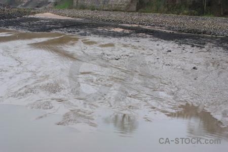 Gray mud sea water beach.