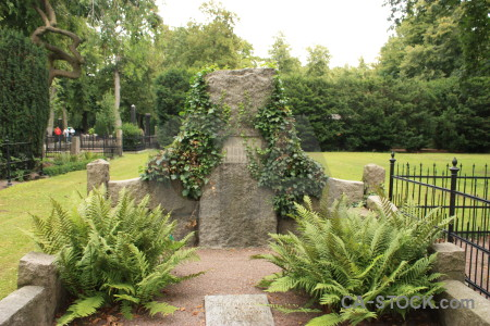 Green cemetery grave statue.