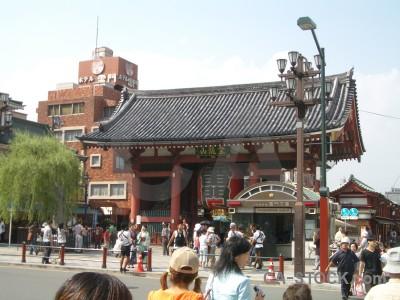 Green person white building oriental.