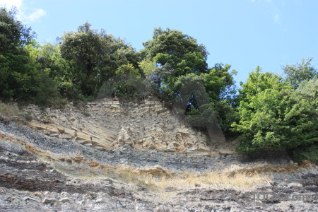 Green rock cliff.