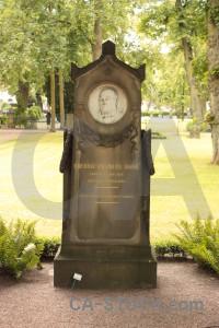 Green statue cemetery grave.