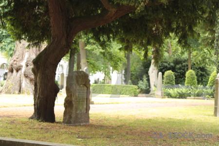 Green statue grave cemetery.