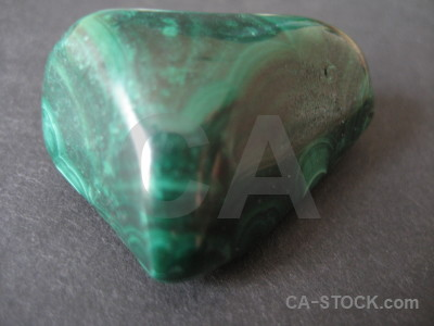 Green stone object polished.