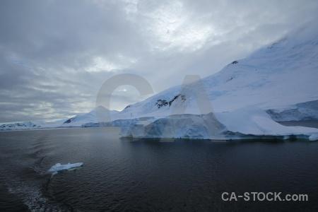 Gunnel channel cloud mountain antarctica cruise sea.