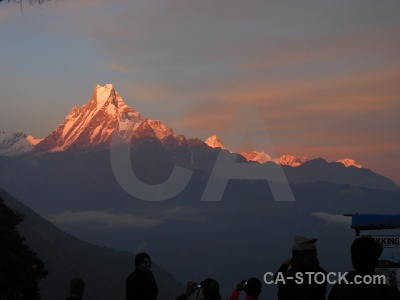 Himalayan machapuchare modi khola valley cloud sunset.