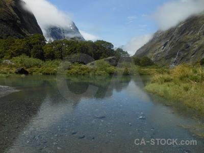 Hollyford river south island sky rock cloud.