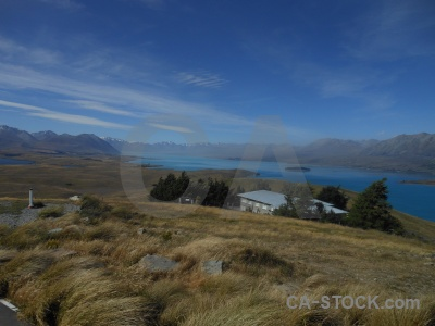 House new zealand mountain lake tekapo field.