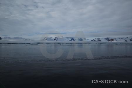 Ice antarctica cruise sea mountain cloud.