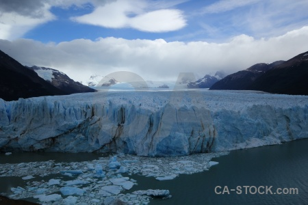 Ice sky perito moreno mountain lake.