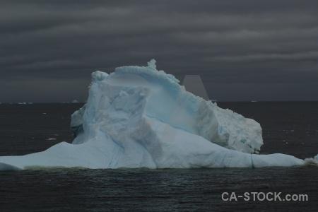 Iceberg antarctica cruise sky marguerite bay adelaide island.
