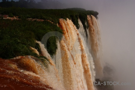 Iguassu falls water iguazu river spray argentina.